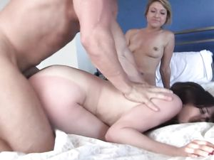 Brunette And Blonde Fucking In A Hot Threesome